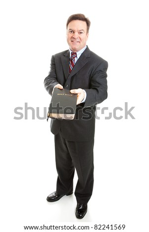 Christian businessman or Bible salesman spreading the word of God.  Full body isolated on white. - stock photo