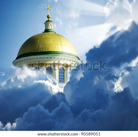 christian church in a dense clouds and sunrays - stock photo
