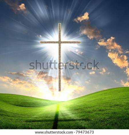 Christian cross against the sky in a blaze of glory. Religious symbol of Christianity - stock photo