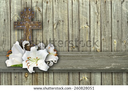 christian cross and three white lily on wood grey background - stock photo