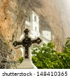 Christian cross in rocky Serbian Orthodox monastery Ostrog, Montenegro - stock photo