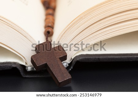 Christian cross necklace on Holy Bible book, Jesus religion concept as good friday or easter festival - stock photo