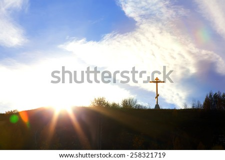 Christian cross on a hill against the sky symbol of faith - stock photo