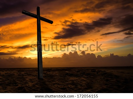 Christian cross on sunset sky. Religion background. - stock photo