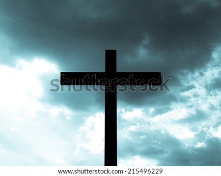 Christian Cross over a blue sky background - cool cyanotype