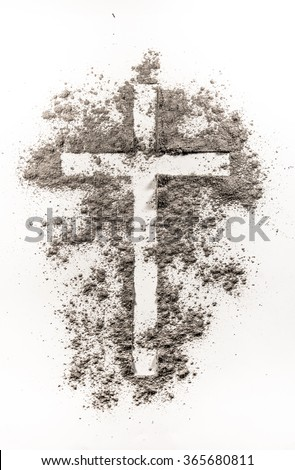 Christian cross symbol made of ash on a white background - stock photo