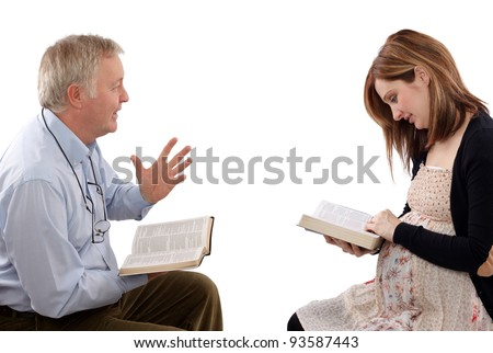 Christian father talking to his daughter from Scripture, about children - stock photo