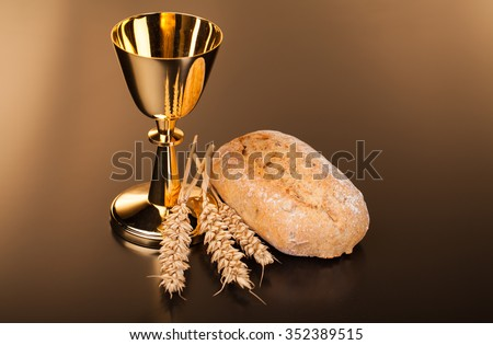 Christian holy communion composition on dark surface - stock photo
