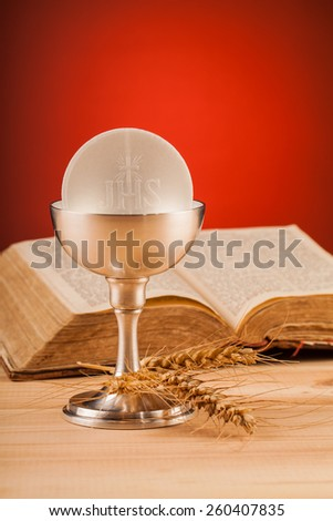 Christian holy communion composition on wooden table - stock photo