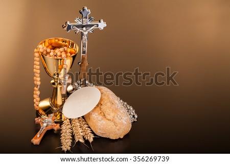 Christian holy communion on dark surface - stock photo