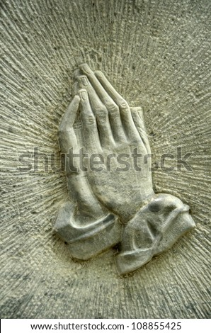 Christian Image Of Jesus' Praying Hands On A Gravestone - stock photo