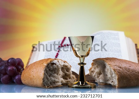 Christian religion, wine, bread and the word of God on yellow background - stock photo