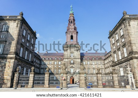 Christianborg palace front view in Copenhagen, Denmark. Copenhagen palace. Copenhagen castle. Main historical palace in Copenhagen, Denmark. Old Copenhagen palace view. Classical Copenhagen palace. - stock photo
