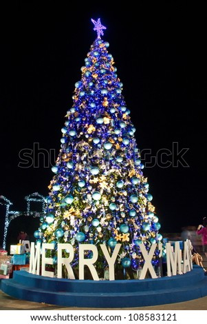 Christians celebrate New Year, often decorated with Christmas lights on the tree well. Symbol of the work is. Santa's Cross, wearing the red uniform. Welcome to the children of God. - stock photo