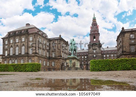 Christiansborg Palace and equestrian statue of Danish King Christian IX in Copenhagen, Denmark. - stock photo