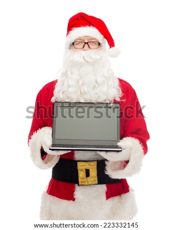 christmas, advertisement, technology, and people concept - man in costume of santa claus with laptop computer - stock photo