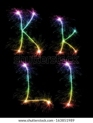 Christmas alphabet created a sparkler,letter k,letter l - stock photo