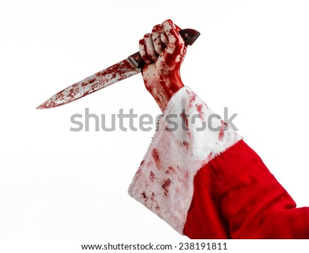 Christmas and Halloween theme: Santa's bloody hands of a madman holding a bloody knife on an isolated white background