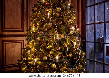 Christmas and New Year background. New Year Tree decorated close up - stock photo