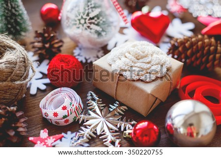 Christmas and New year background with presents, ribbons, balls and different decorations on wooden background