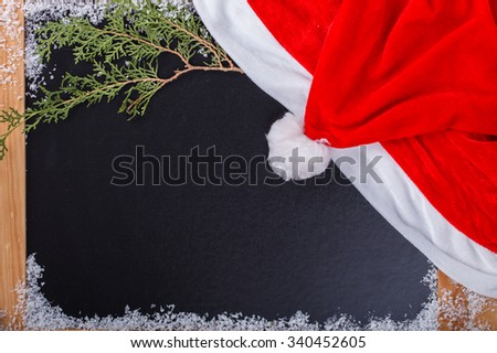 Christmas and New Year background. wooden Board with a red cap of Santa Claus.Copy space.selective focus.