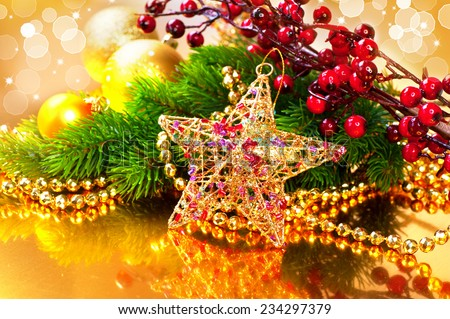 Christmas and New Year Baubles and Decorations over golden background. Christmas tree, garland, bulbs on glowing background - stock photo