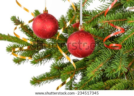 christmas and new year concept: red balls on the green spruce - stock photo