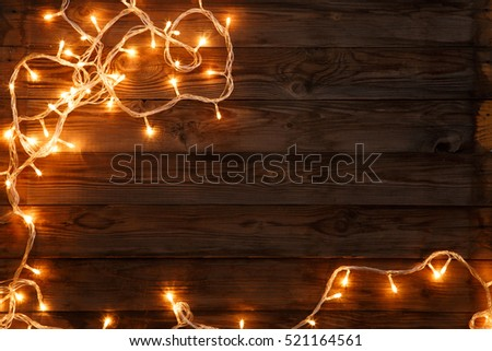 Christmas and new year dark brown wooden background decorated lightbulbs