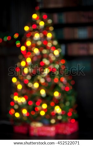 Christmas and New Year decorated interior room, defocused New year tree - stock photo