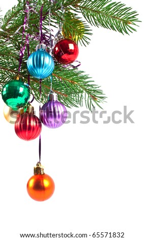 Christmas and new-year decorations. Fir tree branch with decoration on a white background - stock photo