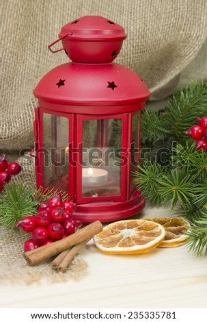 Christmas and New Year Decorations on flax background.Lantern light and tinsel  - stock photo