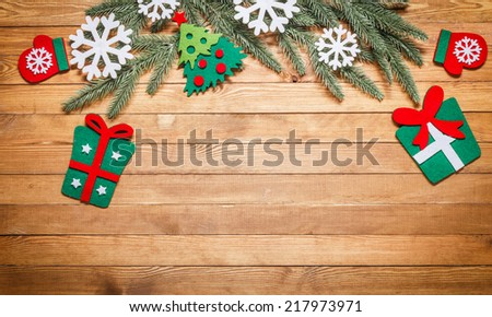 Christmas and New Year decorations on wooden background of aged boards with a field for the text. - stock photo