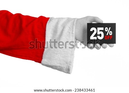 Christmas and New Year discounts topic: Santa's hand holding a black card with a 25 percent discount on an isolated white background - stock photo