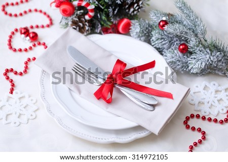 Christmas And New Year Holiday Table Setting. Celebration. Place setting for Christmas Dinner. Holiday Decorations.  - stock photo