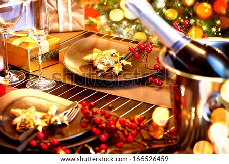 Christmas And New Year Holiday Table Setting with Champagne. Celebration. Place setting for Christmas Dinner. Holiday Decorations. Decor. Served Table - stock photo