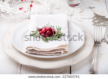 Christmas And New Year Holiday Table Setting with cranberry and rosemary decoration. Holiday decoration. - stock photo