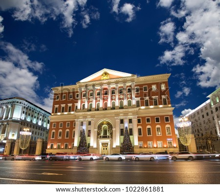 Christmas and New Year holidays illumination in Moscow city center and Government building on Tverskaya street at night, Russia