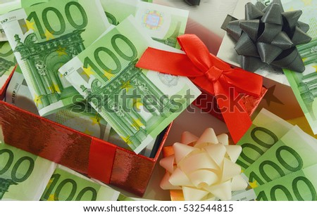 Christmas and New Year is time to spend money. gift with money one hundred Euro bank.