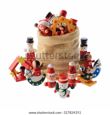 Christmas and New Year: lot of multicolored Christmas decorations in a Santa Claus bag, isolated on white background - stock photo
