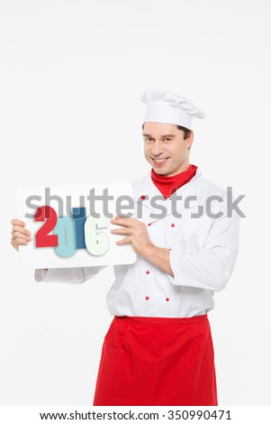 Christmas and New Year menu. Male chef holding a plate in 2016 isolated over white background - stock photo