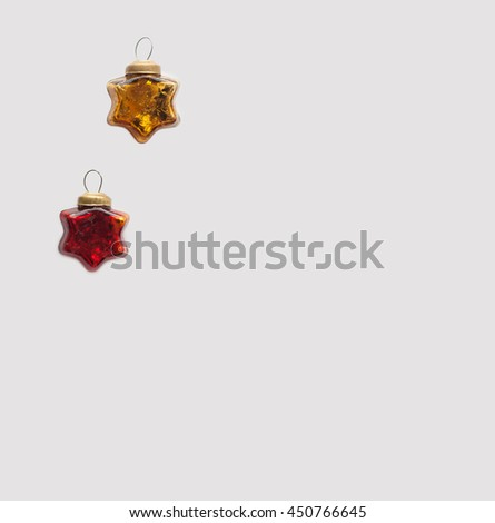 Christmas and new year red and gold and toys. Glassy vintage stars on a light background - stock photo
