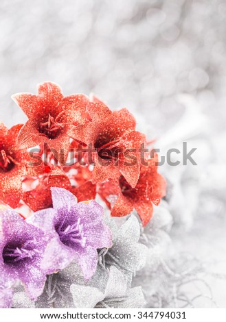 Christmas and New Year's flowers on snow background - stock photo