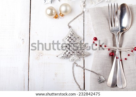 Christmas and New year table place setting with christmas decorations. Copy space. - stock photo