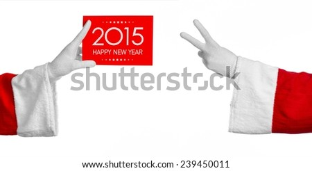 Christmas and New Year theme: Santa's hand holding a red card with New Year Greetings 2015 on a white background isolated