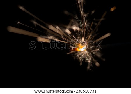 Christmas and newyear party sparkler on black - stock photo