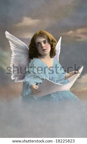 Christmas Angel - a vintage, 1913, hand-tinted photo - stock photo
