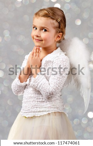Christmas Angel - lovely little praying  girl - stock photo