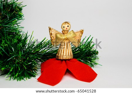 Christmas angel made from straw with green xmas tree - stock photo