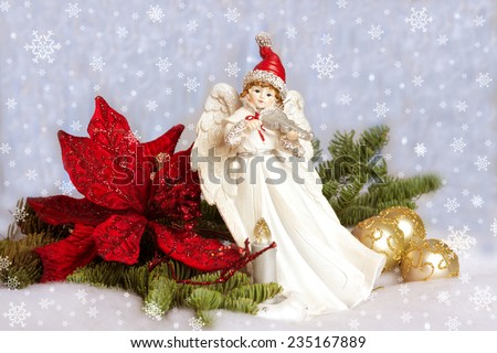 Christmas  Angel playing  violin  candlelight, red poinsettias; pine tree branch with gold glitter balls. Christmas spirit; White blue background with snow flakes  - stock photo