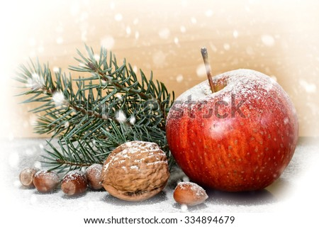 Christmas apple and nuts - stock photo